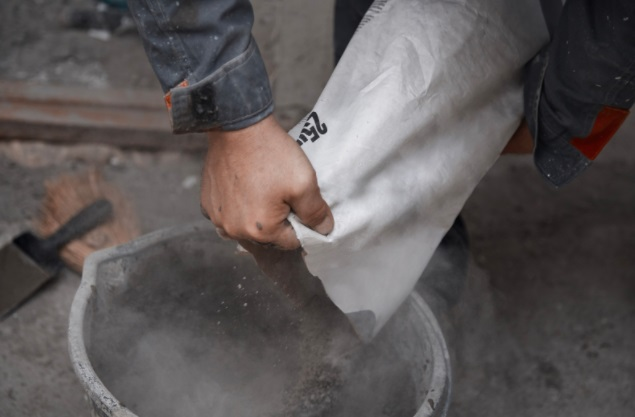 man mixing a cement