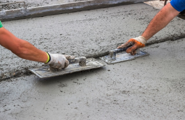 2 workers leveling a surface
