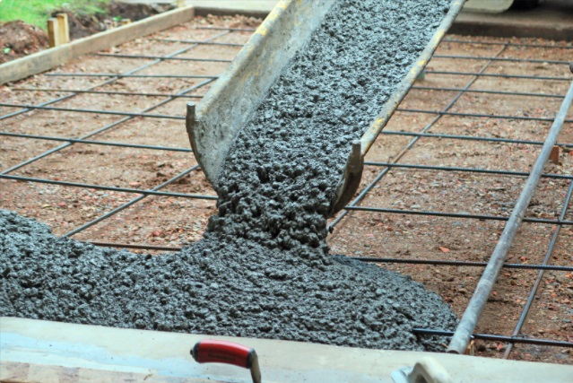 pouring cement on the driveway